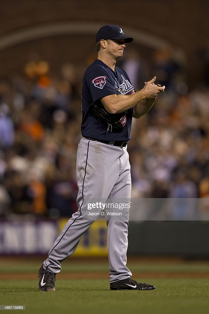 <a gi-track='captionPersonalityLinkClicked' href=/galleries/search?phrase=Gavin+Floyd&family=editorial&specificpeople=224627 ng-click='$event.stopPropagation()'>Gavin Floyd</a> #32 of the Atlanta Braves reacts after giving up a two run triple to Tyler Colvin #10 of the San Francisco Giants (not pictured) during the seventh inning at AT&T Park on May 12, 2014 in San Francisco, California. The San Francisco Giants defeated the Atlanta Braves 4-2.