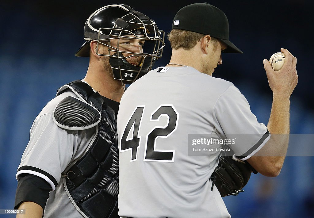 <a gi-track='captionPersonalityLinkClicked' href=/galleries/search?phrase=Gavin+Floyd&family=editorial&specificpeople=224627 ng-click='$event.stopPropagation()'>Gavin Floyd</a> (R) of the Chicago White Sox gets a visit to the mound from <a gi-track='captionPersonalityLinkClicked' href=/galleries/search?phrase=Tyler+Flowers&family=editorial&specificpeople=4217244 ng-click='$event.stopPropagation()'>Tyler Flowers</a> (L) during MLB game action against the Toronto Blue Jays on April 15, 2013 at Rogers Centre in Toronto, Ontario, Canada. All uniformed team members are wearing jersey number 42 in honor of Jackie Robinson Day.