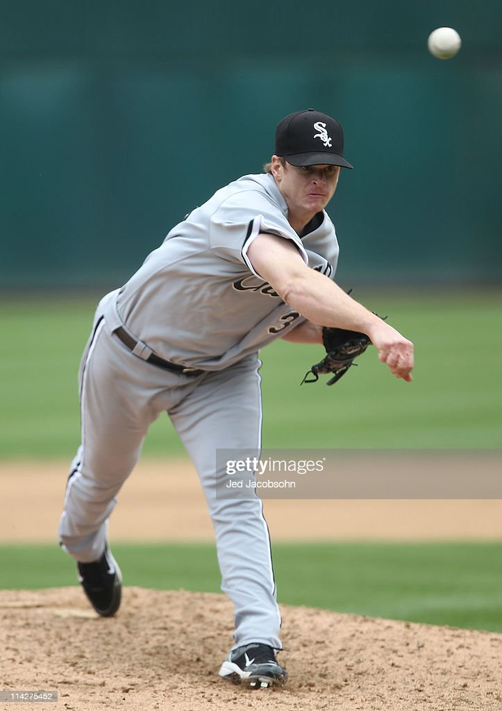 <a gi-track='captionPersonalityLinkClicked' href=/galleries/search?phrase=Gavin+Floyd&family=editorial&specificpeople=224627 ng-click='$event.stopPropagation()'>Gavin Floyd</a> #34 of the Chicago White Sox pitches against the Oakland Athletics during a Major League Baseball game at the Oakland-Alameda County Coliseum on May 14, 2011 in Oakland, California.
