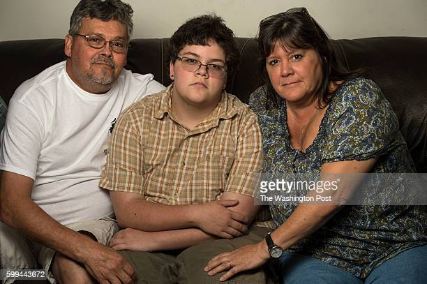 Gavin Grimm center is photographed at his home with his parents David Grimm left and mom Deirdre Grimm in Gloucester Virginia on Sunday August 21...