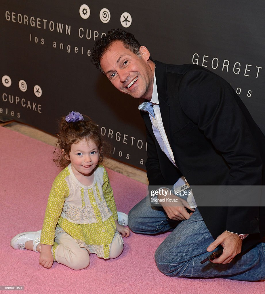 Gavin Keilly and daughter Morgan Keilly attend the Los Angeles Grand Opening of Georgetown Cupcake Los Angeles on November 15, 2012 in Los Angeles, California.