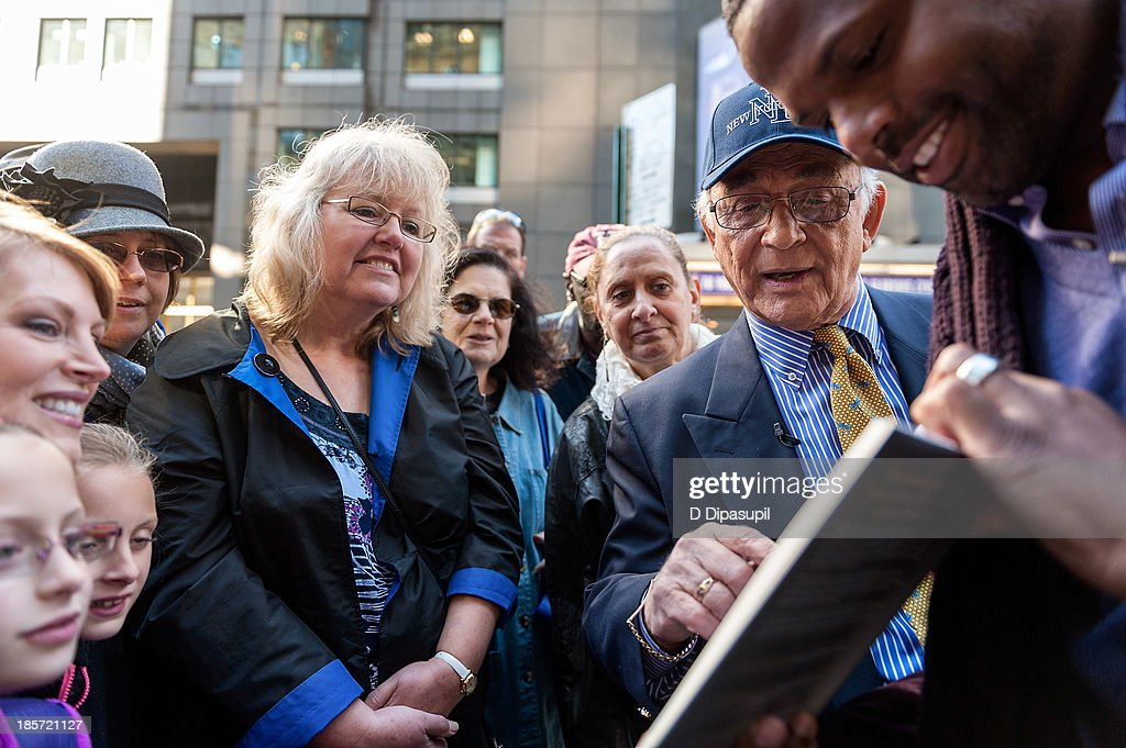 <a gi-track='captionPersonalityLinkClicked' href=/galleries/search?phrase=Gavin+MacLeod&family=editorial&specificpeople=228310 ng-click='$event.stopPropagation()'>Gavin MacLeod</a> (2nd R) visits 'Extra' in Times Square on October 24, 2013 in New York City.