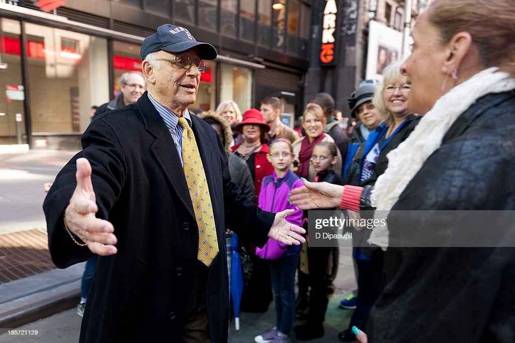 <a gi-track='captionPersonalityLinkClicked' href=/galleries/search?phrase=Gavin+MacLeod&family=editorial&specificpeople=228310 ng-click='$event.stopPropagation()'>Gavin MacLeod</a> (L) visits 'Extra' in Times Square on October 24, 2013 in New York City.