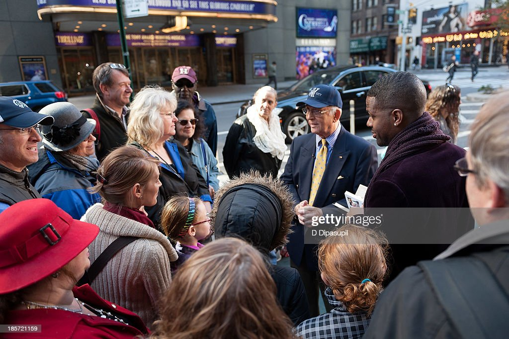 Gavin MacLeod (2nd R) visits 'Extra' in Times Square on October 24, 2013 in New York City.