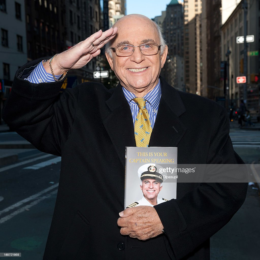 <a gi-track='captionPersonalityLinkClicked' href=/galleries/search?phrase=Gavin+MacLeod&family=editorial&specificpeople=228310 ng-click='$event.stopPropagation()'>Gavin MacLeod</a> visits 'Extra' in Times Square on October 24, 2013 in New York City.