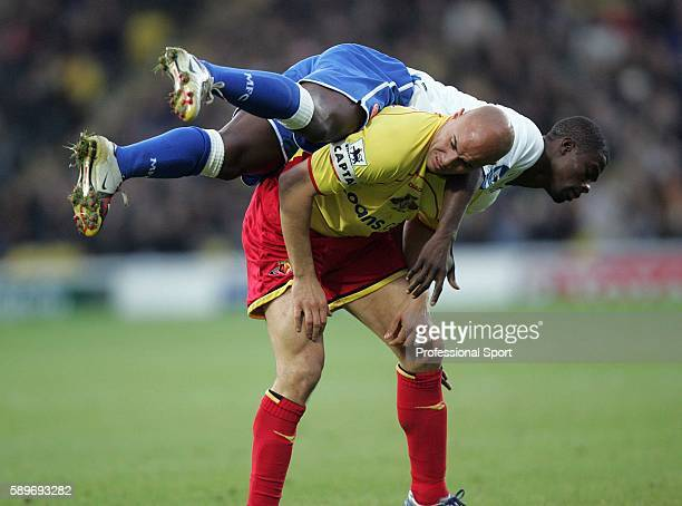 Gavin Mahon of Watford ends up with George Boateng of Middlesbrough on his back during the Barclays Premiership match between Watford and...