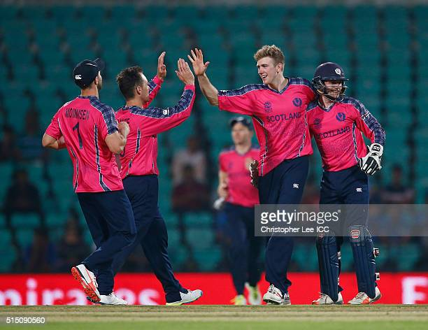 Gavin Main of Scotland is congratulated on the run out of Tanwir Afzal of Hong Kong by Matthew Cross of Scotland during the ICC Twenty20 World Cup...