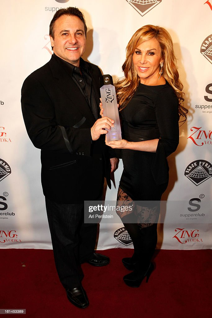 <a gi-track='captionPersonalityLinkClicked' href=/galleries/search?phrase=Gavin+Maloof&family=editorial&specificpeople=240394 ng-click='$event.stopPropagation()'>Gavin Maloof</a> and Adrienne Maloof arrive at Post Grammy Party At Supperclub Hosted By Chris Brown And ZING Vodka Los Angeles on February 10, 2013 in Los Angeles, California.