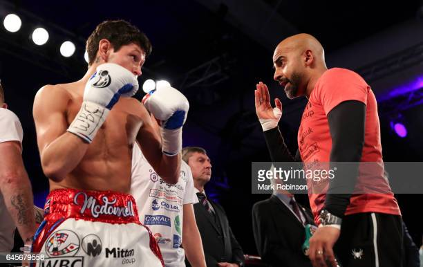 Gavin McDonnell trainer Dave Coldwell speaks to his fighter at the start of his fight against Rey for the Vacant WBC SuperBantamweight Championship...