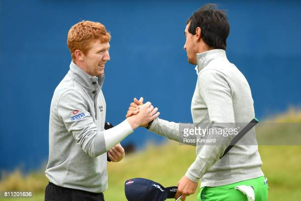Gavin Moynihan of Ireland shakes hands with Matteo Manassero of Italy on the 18th green during the final round of the Dubai Duty Free Irish Open at...