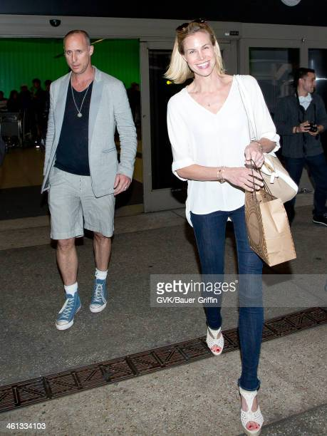 Gavin O'Connor and Brooke Burns are seen arriving at LAX airport on January 07 2014 in Los Angeles California