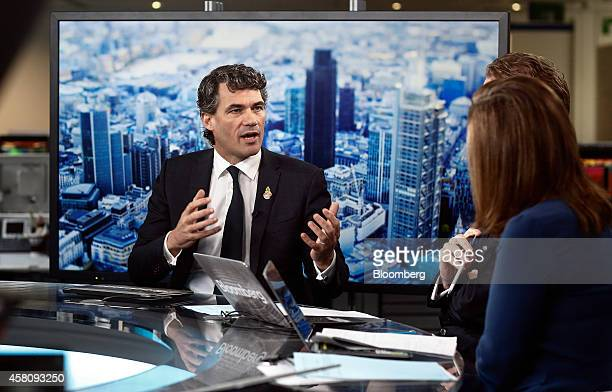 Gavin Patterson chief executive officer of BT Group Plc left gestures as he speaks during a Bloomberg Television interview in London UK on Thursday...