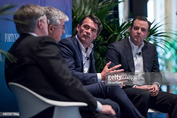 Gavin Patterson chief executive officer of BT Group PLC second right speaks as Hubert Joly chairman and chief executive officer of Best Buy Co Inc...