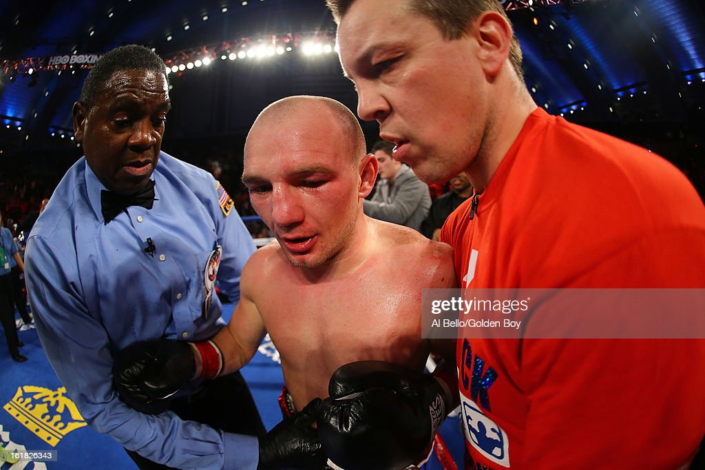 Gavin Rees is helped back to his corner after being TKO'd in the fifth round by Adrien Broner after their WBC Lightweight Title fight at Atlantic City Boardwalk Hall on February 16, 2013 in Atlantic City, New Jersey.