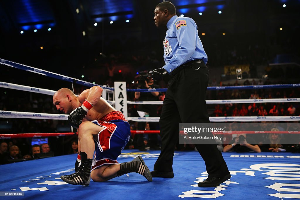 <a gi-track='captionPersonalityLinkClicked' href=/galleries/search?phrase=Gavin+Rees&family=editorial&specificpeople=3375830 ng-click='$event.stopPropagation()'>Gavin Rees</a> is knocked down by Adrien Broner during their WBC Lightweight Title fight at Atlantic City Boardwalk Hall on February 16, 2013 in Atlantic City, New Jersey.
