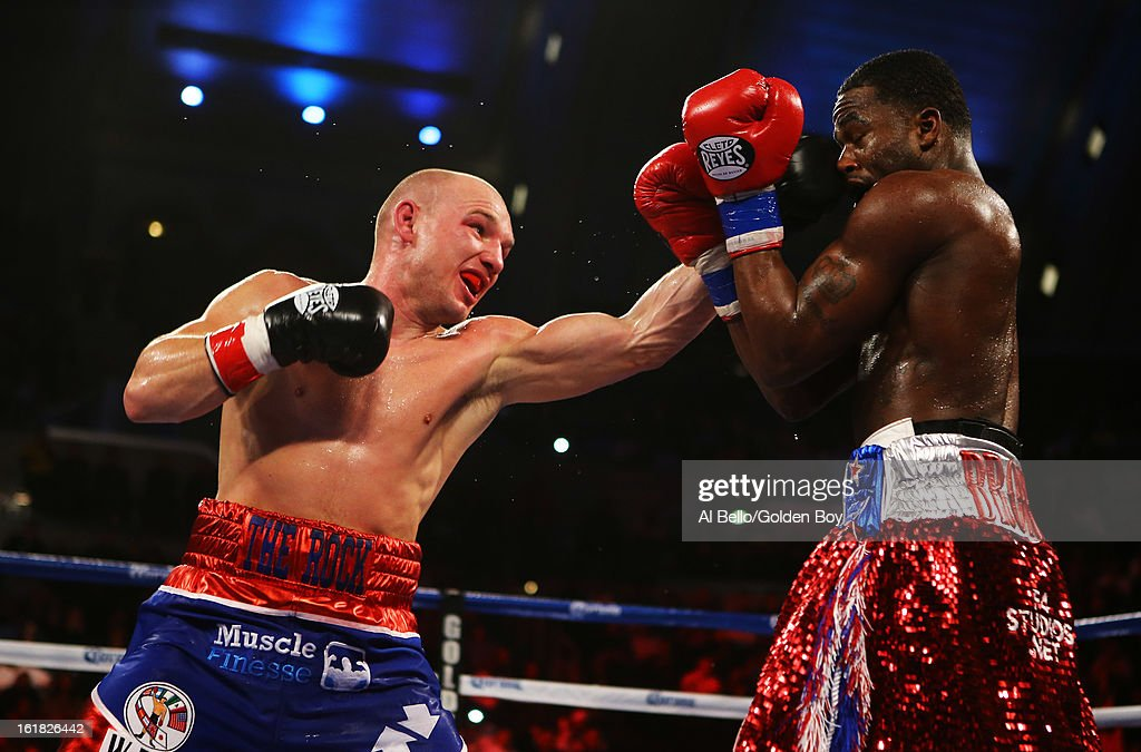 Gavin Rees is punches Adrien Broner during their WBC Lightweight Title fight at Atlantic City Boardwalk Hall on February 16, 2013 in Atlantic City, New Jersey.