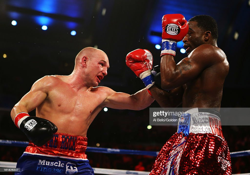 Gavin Rees punches Adrien Broner during their WBC Lightweight Title fight at Atlantic City Boardwalk Hall on February 16, 2013 in Atlantic City, New Jersey.
