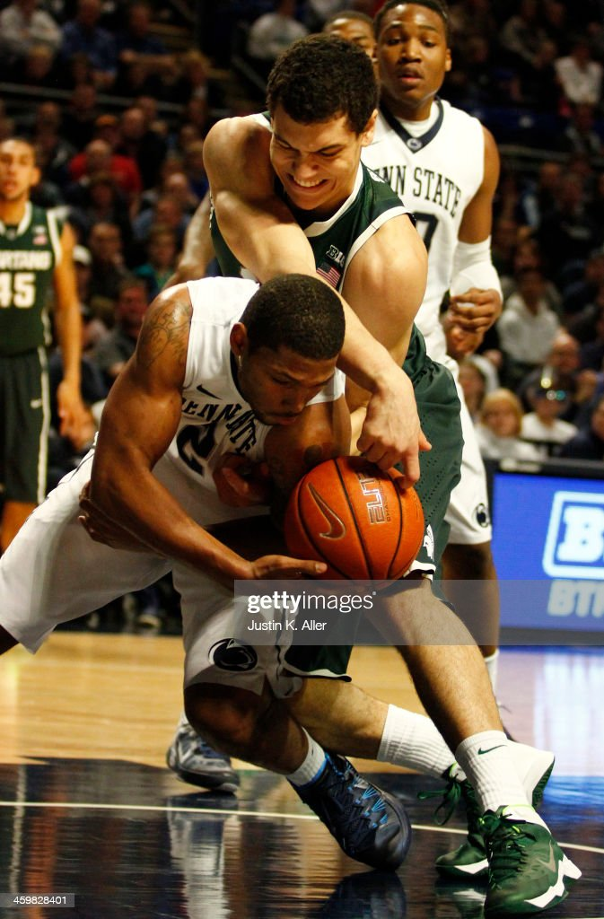 Gavin Schilling #34 of the Michigan State Spartans and D.J. Newbill #2 of the Penn State Nittany Lions battle for a rebound at the Bryce Jordan Center on December 31, 2013 in State College, Pennsylvania.