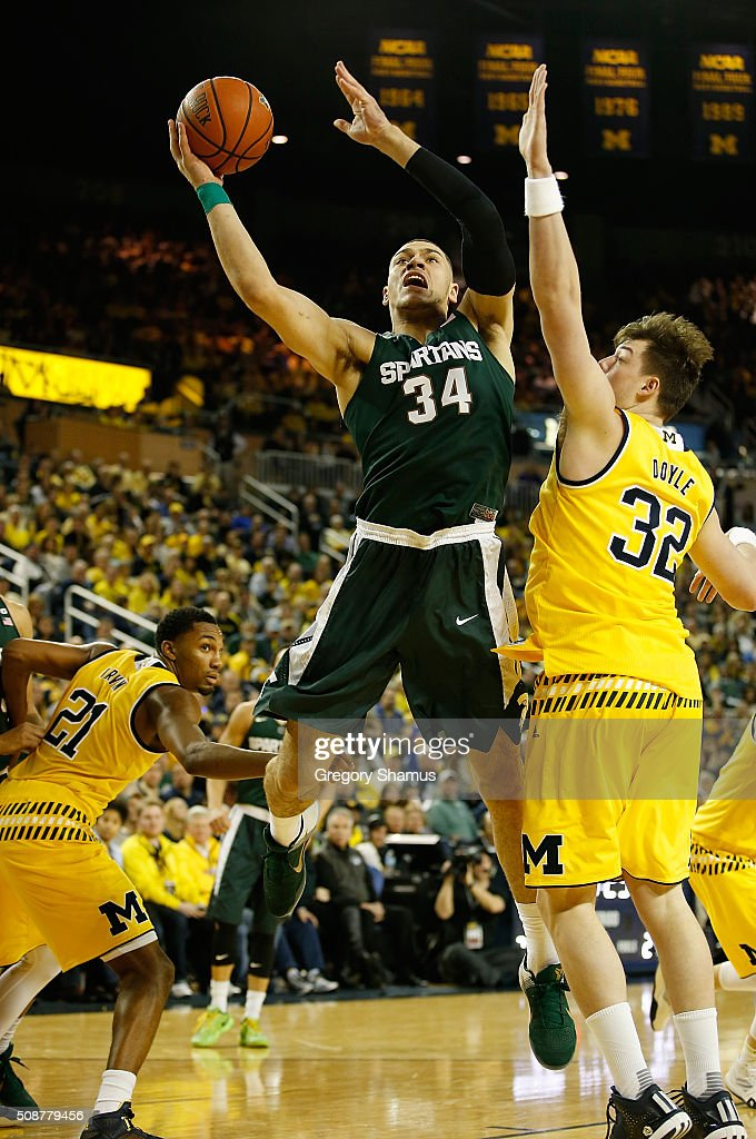 <a gi-track='captionPersonalityLinkClicked' href=/galleries/search?phrase=Gavin+Schilling&family=editorial&specificpeople=11623528 ng-click='$event.stopPropagation()'>Gavin Schilling</a> #34 of the Michigan State Spartans takes a second half shot around Ricky Doyle #32 of the Michigan Wolverines at Crisler Center on January 6, 2016 in Ann Arbor, Michigan.