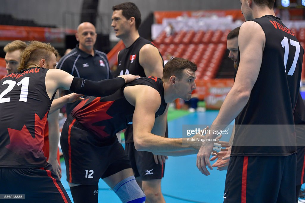 Gavin Schmitt #12of Canada high-fives prior to the Men's World Olympic Qualification game between Venezuela and Canada at Tokyo Metropolitan Gymnasium on June 1, 2016 in Tokyo, Japan.