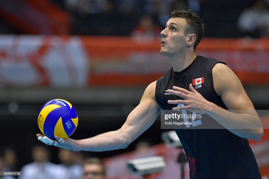 Gavin Schmitt #12 of Canada serves the ball during the Men's World Olympic Qualification game between Poland and Canada at Tokyo Metropolitan Gymnasium on May 28, 2016 in Tokyo, Japan.