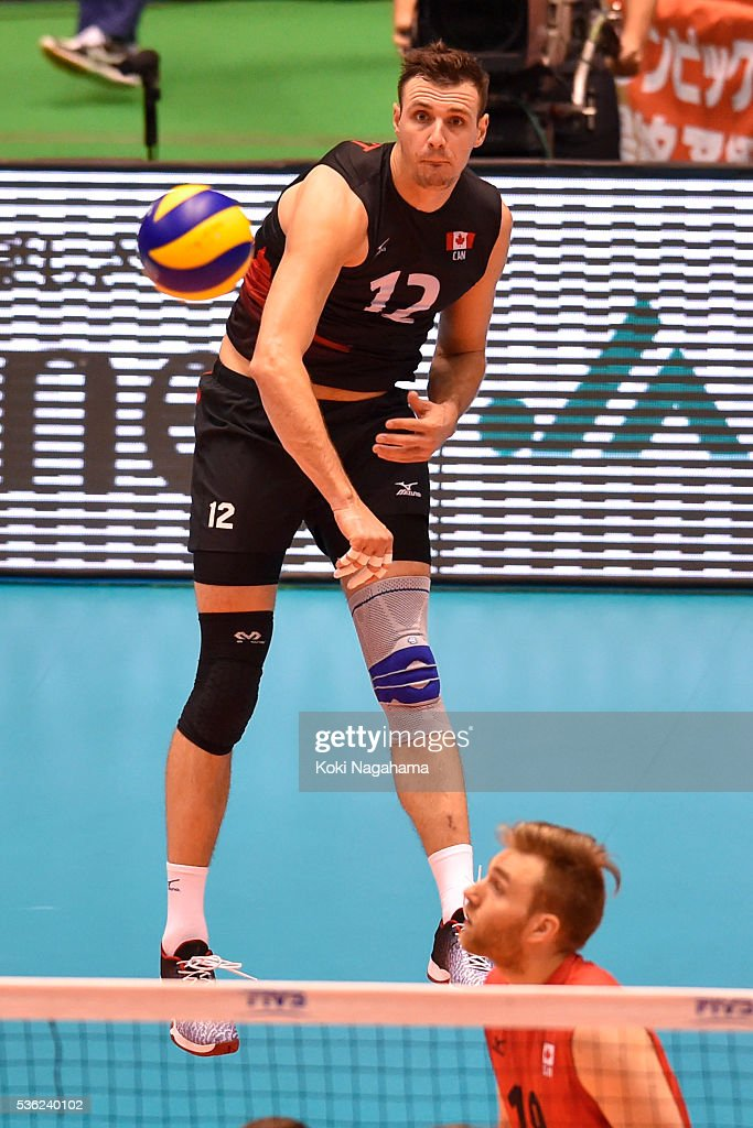 Gavin Schmitt #12 of Canada serves the ball during the Men's World Olympic Qualification game between Venezuela and Canada at Tokyo Metropolitan Gymnasium on June 1, 2016 in Tokyo, Japan.