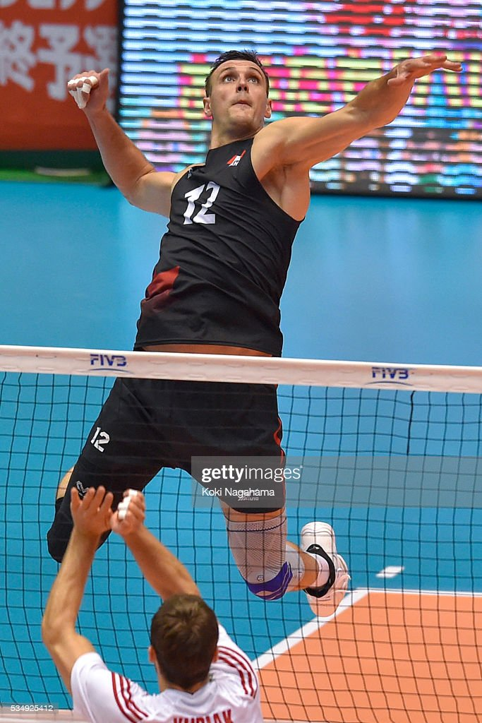 Gavin Schmitt #12 of Canada spikes the ball during the Men's World Olympic Qualification game between Poland and Canada at Tokyo Metropolitan Gymnasium on May 28, 2016 in Tokyo, Japan.