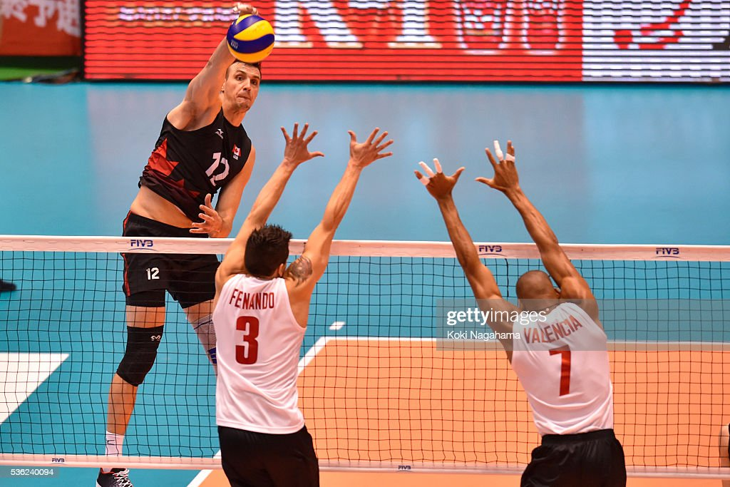 Gavin Schmitt #12 of Canada spikes the ball during the Men's World Olympic Qualification game between Venezuela and Canada at Tokyo Metropolitan Gymnasium on June 1, 2016 in Tokyo, Japan.