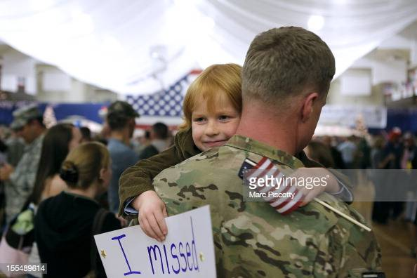 Gavin Shaw flashes a smile as he hugs his father Master Sergeant Adam Shaw during a Welcome Home Ceremony for approximately 230 4th Brigade Combat...