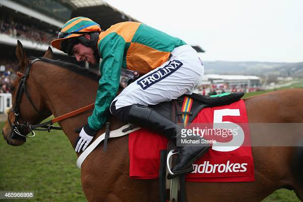 Gavin Sheehan riding Cole Harden celebrates victory in the Ladbrokes World Hurdle Race during day three of the Cheltenham Festival at Cheltenham...