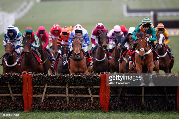 Gavin Sheehan riding Cole Harden lead all the way to win The Ladbrokes World Hurdle Race at Cheltenham racecourse on March 12 2015 in Cheltenham...