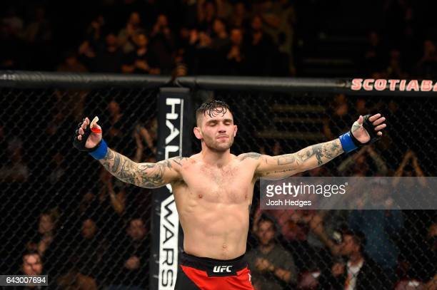 Gavin Tucker of Canada celebrates after defeating Sam Sicilia in their featherweight fight during the UFC Fight Night event inside the Scotiabank...