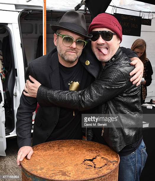 Gavin Turk and Damien Hirst attend the Vauxhall Art Car Boot Fair 2015 on June 14 2015 in London England