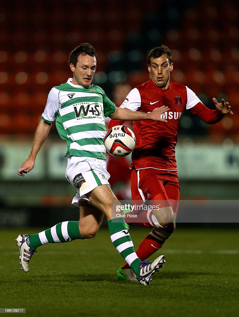 Gavin Williams of Yeovil Town is challanged by Gary Sawyer of Leyon Orient during the Johnstone's Paint Trophy southern section semi final between Leyton Orient and Yeovil Town at the Matchroom Stadium on January 8, 2013 in London, England.