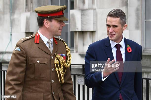 Gavin Williamson arrives with Colonel John Clark Military Advisor to the Prime Minister at the Ministry of Defence after he was announced as the new...
