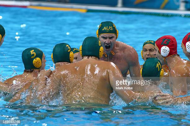 Gavin Woods of Australia leads his team in a pre game cheer in the Men's Water Polo Preliminary Round Group A match between Australia and Italy on...