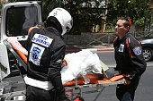 Gavriel Friedson and Daniel Shore volunteers of 'United Hatzalah' a network of volunteer medics across Israel help to load a patient into an...