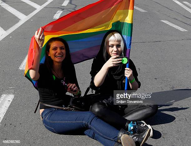 A gay activist holds the rainbow flag during the Pride Parade on September 28 2014 in Belgrade Serbia Serbian gays and lesbians staged their first...