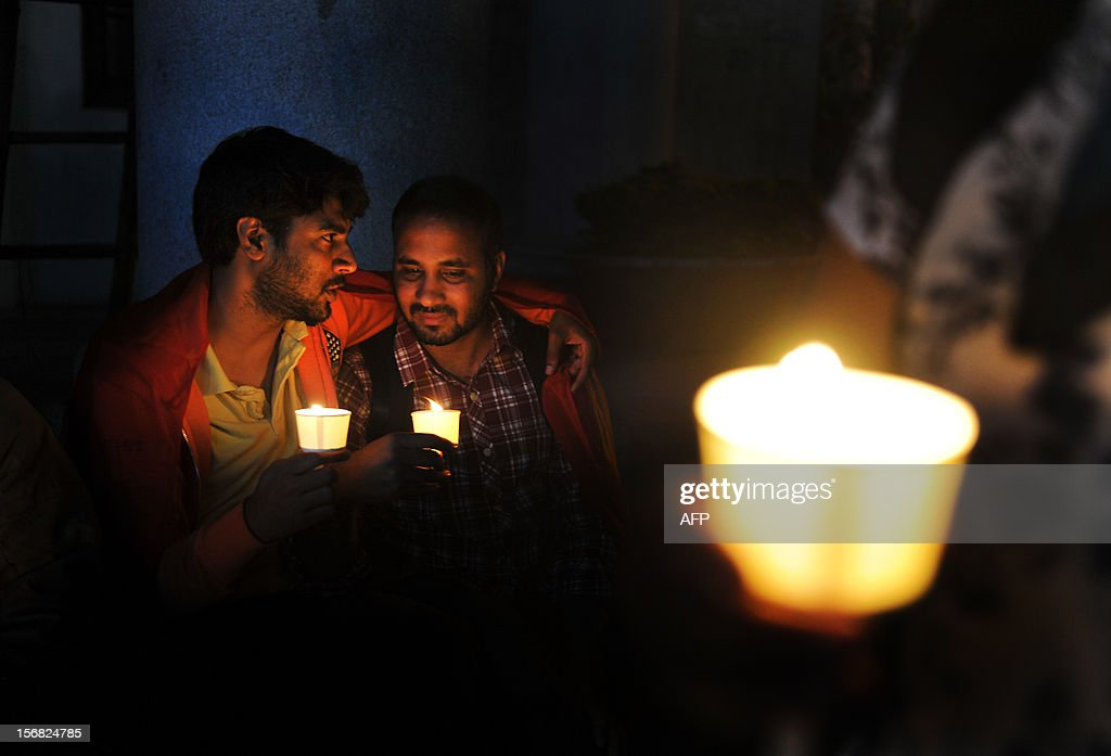 Gay activists belonging to the Coalition for Sexual Minority Rights (CSMR) take part in a candlelight vigil held as part of Transgender Day Remembrance held in Bangalore on November 22, 2012. The candle light vigil marks the start of the annual 10-day Bengaluru Pride and Karnataka Queer Habba 2012. AFP PHOTO/Manjunath KIRAN