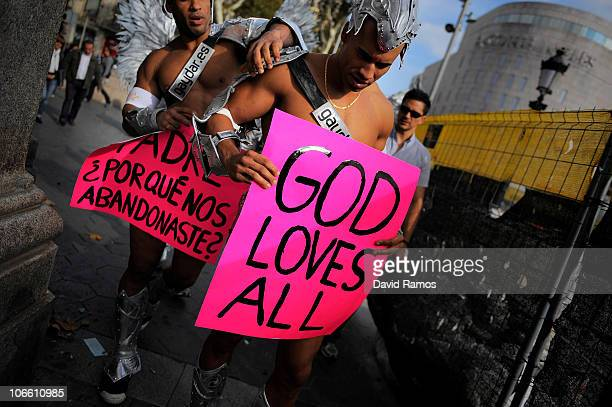 Gay activists take part in a protest during a visit by Pope Benedit XVI to the La Sagrada Familia on November 7 2010 in Barcelona Spain Pope Benedit...