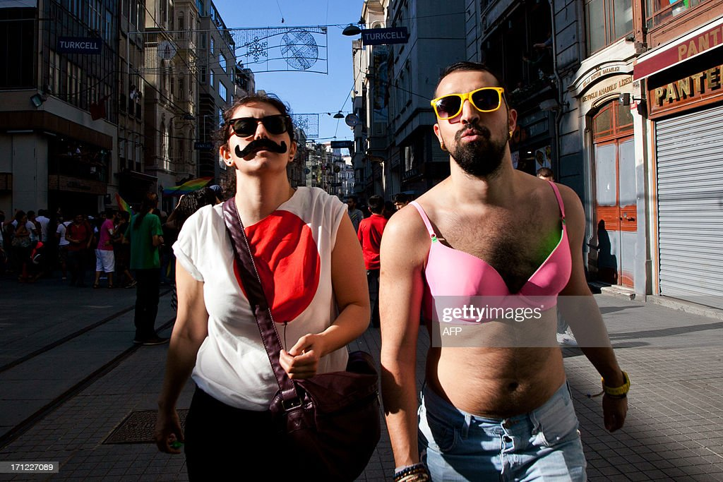 Gay and human rights activists march during anti-government protests on Istiklal Street, the main shopping corridor on June 23, 2013 in Istanbul, Turkey. The protest began in late May over the Gezi Park redevelopment project but swiftly turned into a protest and street party against Prime Minister Recep Tayyip Erdogan and what protestors call his increasingly authoritarian rule. The protest has spread to dozens of cities in Turkey, in secular anger against Erdogan and his Islam-rooted Justice and Development Party.