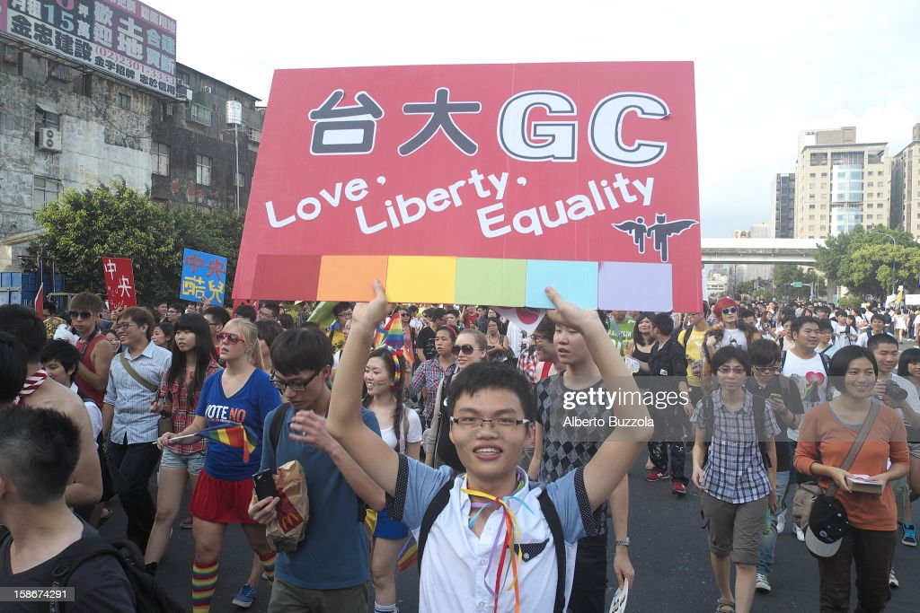Gay and Lesbian Pride Parade held in Taipei annually and attracting thousands of participants. A man from the Gay Community of Taiwan holds a placard..