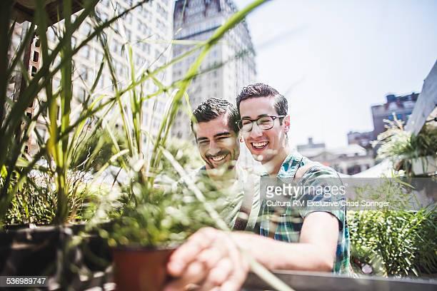 Gay couple buying plants