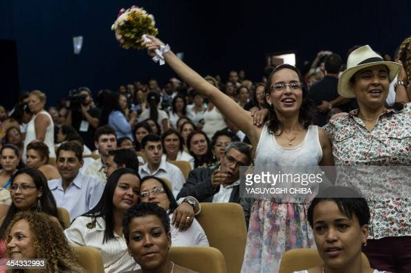 A gay couple celebrates after getting married at the Court of Justice of the State of Rio de Janeiro on December 8 2013 130 gay couples are getting...