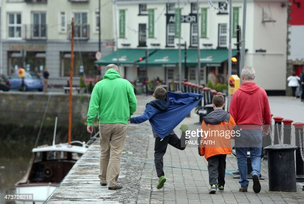 Gay couple Donal Traynor walks with his partner Joseph Bowlby and their adopted sons at their home in Dungarvan on May 14 2015 When Donal Traynor met...