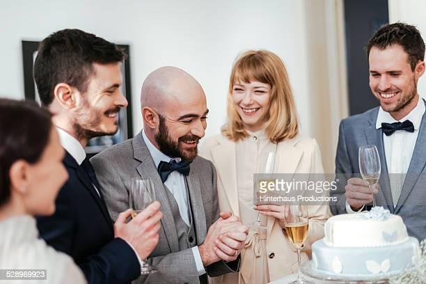 Gay Couple Enjoying Their Wedding Cake