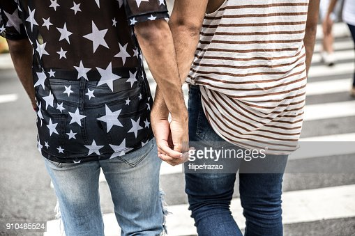 Gay couple having a great time together in the city : Stock Photo