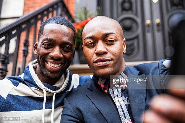 Gay couple having a selfie on steps in New York