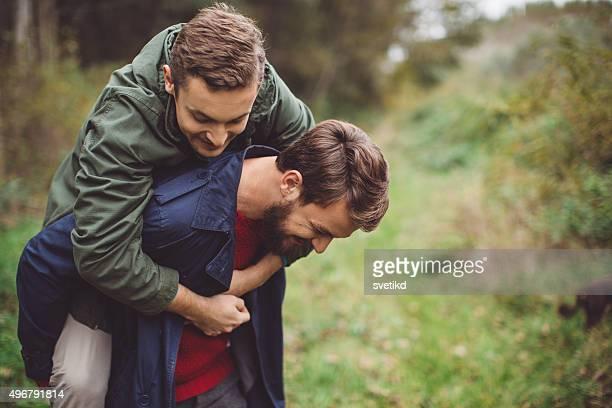 Gay couple having fun outdoor.