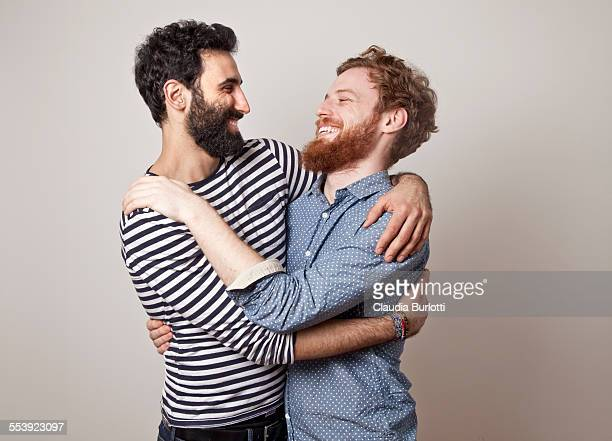 Gay couple hugging and laughing